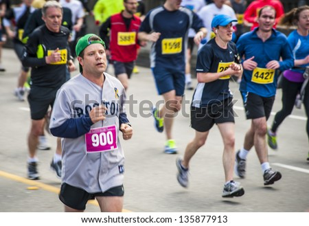 VANCOUVER, CANADA - APRIL 21:  Actor Sean Astin (#900) in the Vancouver Sun Run, April 21, 2013. Many runners wore blue and yellow in support of the Boston marathon, where bombings occurred earlier. - stock photo
