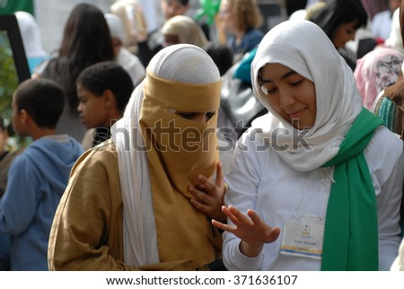 VANCOUVER, CANADA - AUGUST 14, 2009: Canadian Muslims attend the Fifth Canadian Islamic Cultural Expo that promotes a better understanding of Islamic culture on Aug.14, 2009 in Vancouver, Canada. - stock photo