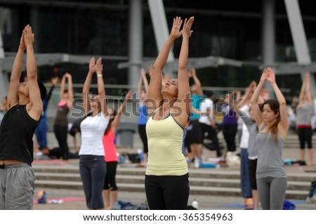 VANCOUVER, CANADA - AUGUST 16, 2014: Hundreds of people took part in the 3rd annual Yogathon 2014 in Vancouver, Canada, Aug.16, 2014.  - stock photo
