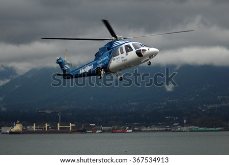 VANCOUVER, CANADA - FEBRUARY 14, 2014: A Sikorsky S76 has been presented to Canadian Breast Cancer Foundation as new partnership to raise funds for cancer research in Vancouver, Canada, Feb.14, 2014. - stock photo