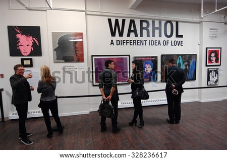 VANCOUVER, CANADA - FEBRUARY 27, 2015: Visitors attend the biggest in Canada exhibition of works of pop art legend Andy Warhol in Yaletown warehouse in Vancouver, Canada, Feb.27, 2015. - stock photo