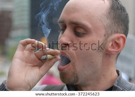 """VANCOUVER, CANADA - July 01, 2008: Thousands of marijuana activists smoked and distributed marijuana to send a """"smoke signal"""" to governments to end pot prohibition, July 1, 2008 in Vancouver, Canada. - stock photo"""