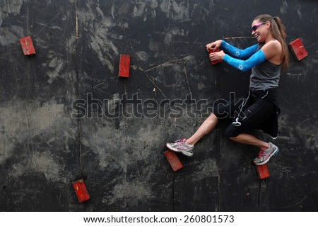 VANCOUVER, CANADA - JUNE 1, 2013: Competitors participate in the 2013 Spartan Race obstacle racing challenge in Vancouver, Canada, on June 1, 2013. - stock photo