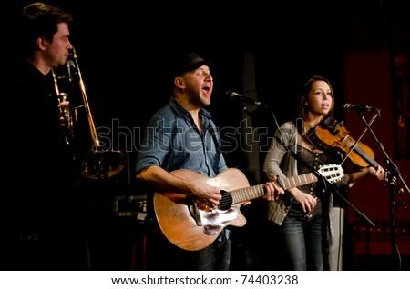 VANCOUVER, CANADA - MARCH 27: Trio Starbirds. Kalissa Hernandez, Nick La Riviere and Tom Landa on the stage of The Jazz Cellar on March 27, 2011 in Vancouver, Canada. - stock photo