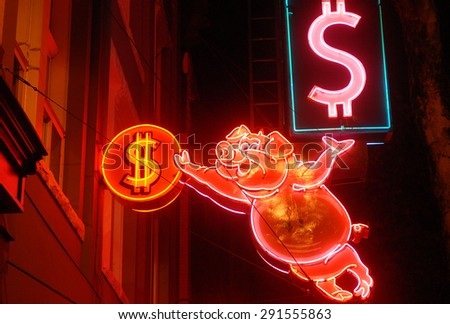 VANCOUVER, CANADA - MAY 2, 2012: A photograph of vintage neon sign still shining in Vancouver's Downtown, one of only handful remaining original neon signs in Vancouver, Canada, May 2, 2012. - stock photo