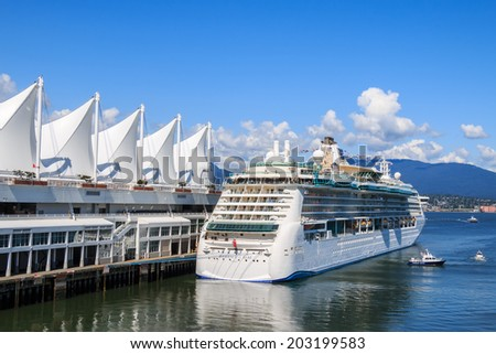 "VANCOUVER, CANADA - MAY 30, 2014: Cruise ship ""Radiance of the Seas"" at Canada Place Harbor on May 30, 2014 in Vancouver. Canada Place, Canada'??s inspiring national landmark, opened in 1986. - stock photo"