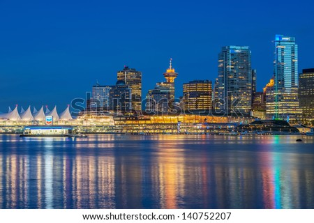 VANCOUVER, CANADA - MAY 24, 2013: View of Downtown Vancouver from Stanley Park on May 24, 2013. Downtown Vancouver is business, cultural, commercial and entertainment center of the city. - stock photo