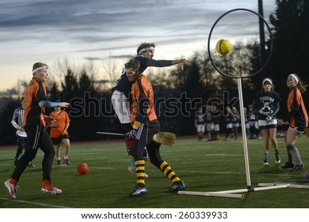VANCOUVER, CANADA - NOVEMBER 22, 2014: University teams play quidditch, the game of Harry Potter books fame, at Simon Fraser University in Burnaby, BC, Canada, on November 22, 2014. - stock photo