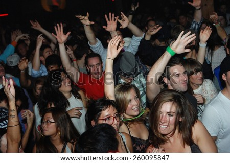 VANCOUVER, CANADA - OCTOBER 5, 2011: Clubgoers enjoy the atmosphere of a nightclub in Vancouver, Canada, on October 5, 2011. - stock photo