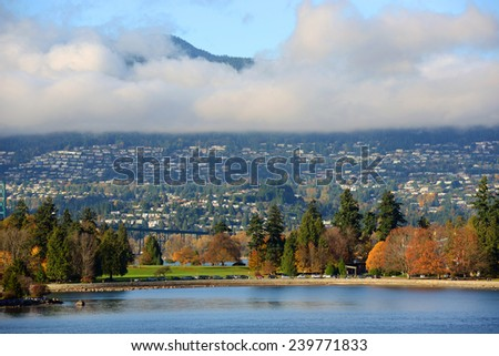Vancouver City and Stanley Park, with Cypress Mountain at the background, British Columbia, Canada - stock photo