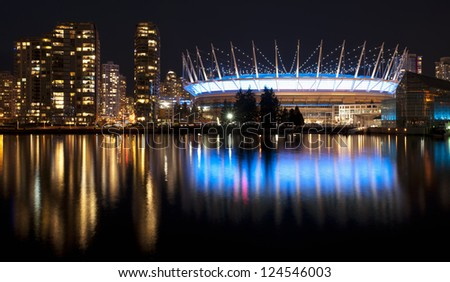 Vancouver - city downtown panorama with Yaletown and BC Place Stadium at the night lights - stock photo