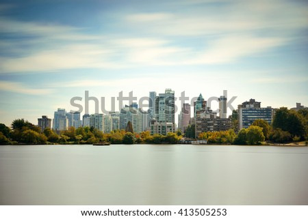Vancouver city skyline viewed from Stanley Park. - stock photo