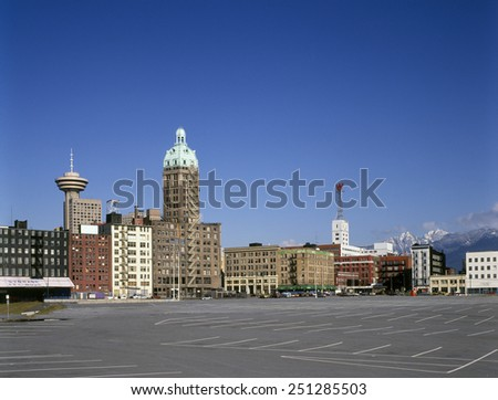 VANCOUVER - DEC 12,1985: Historic view of The Dominion Building, Sun Tower, Woodward's Building, Harbour Centre and buildings at W.Hastings, Water, Beatty and W.Pender streets on the picture from 1985 - stock photo