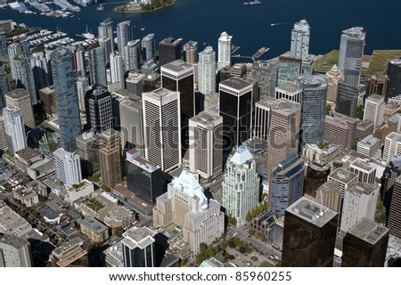 Vancouver - downtown skyscrapers and Coal Harbour, aerial - stock photo