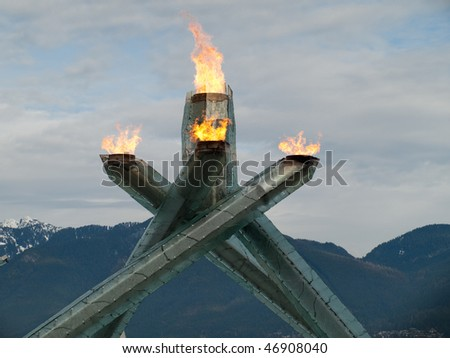 VANCOUVER - FEB 16: The beautiful sculpture holding the Olympic flame illuminates Vancouver Harbour during the Vancouver 2010 Olympic Games on Vancouver British Columbia, Canada, February 16 2010 - stock photo