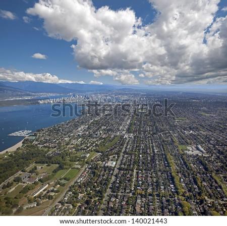 Vancouver - Metro Vancouver with Kitsilano, English Bay, downtown, Stanley Park and Coast Mountains - stock photo