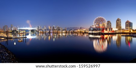 VANCOUVER - OCTOBER 17: Science World and BC Place Stadium in Vancouver, Canada on October 17, 2013. Vancouver has been ranked the third most liveable city in the world for the second year in a row. - stock photo