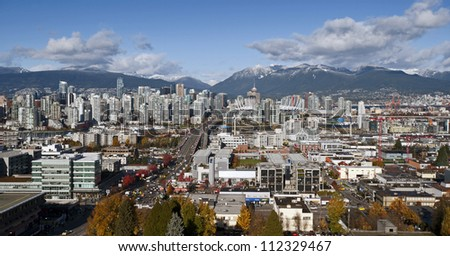 Vancouver - Panoramic downtown and Coast Mountains - stock photo
