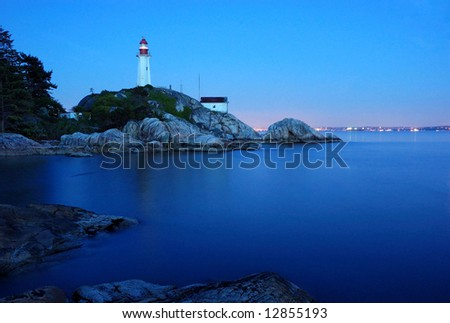 vancouver's atkinson point lighthouse at night - stock photo