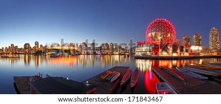 VANCOUVER - SEPTEMBER 9: Science World and BC Place Stadium in Vancouver, Canada on September 9, 2013. Vancouver has been ranked the third most liveable city in the world for the second year in a row. - stock photo