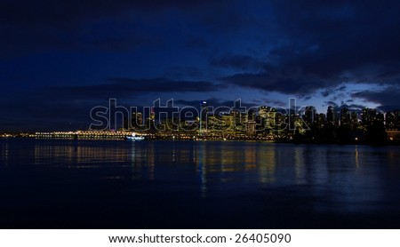 Vancouver skyline at night from Stanley park - stock photo