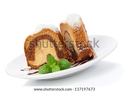 Vanilla and chocolate cake with mint laves  isolated on white - stock photo