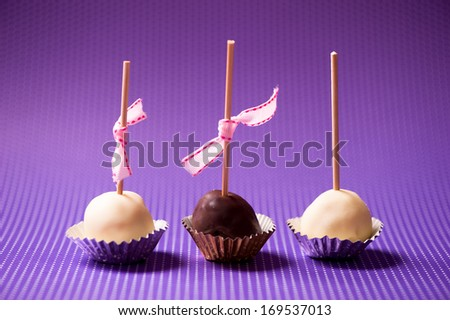 vanilla and chocolate pastry cookies isolated on colorful background - stock photo