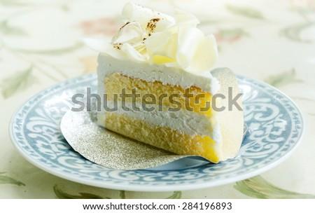 Vanilla cake and white chocolate topping - stock photo