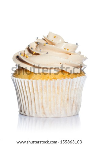 Vanilla Cupcake Decorated With Colored Balls iSolated on White Background. - stock photo