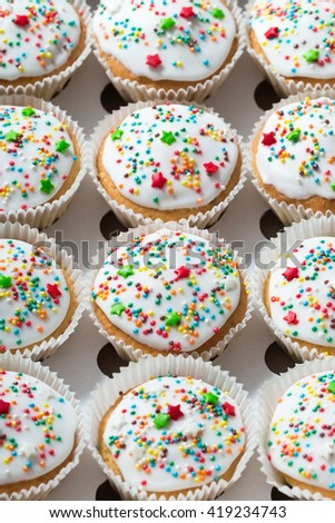 Vanilla cupcakes with white glaze, cupcake packaging, delivery box, selective focus, close up - stock photo