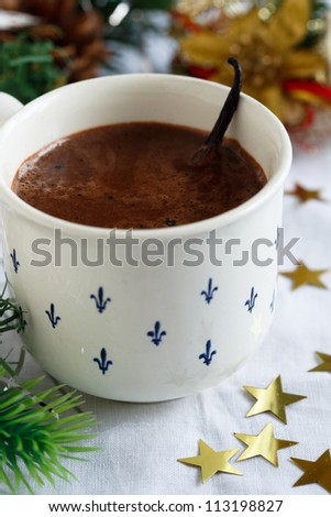 Vanilla hot chocolate in Christmas decoration - stock photo