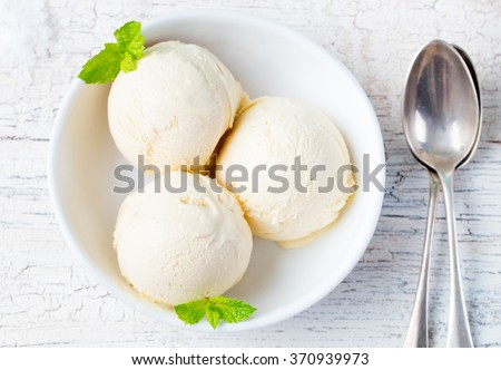 Vanilla Ice Cream with Mint in bowl Homemade Organic product Top view - stock photo