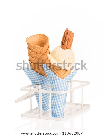 Vanilla ice cream with waffle cones on a white background - stock photo