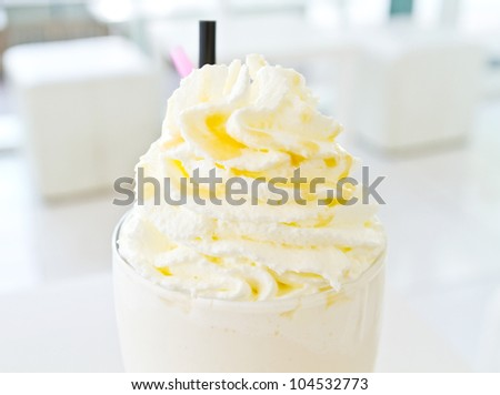Vanilla milk and whipped cream in white room - stock photo