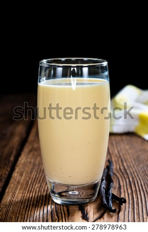 Vanilla Milkshake on an old wooden background (close-up shot) - stock photo