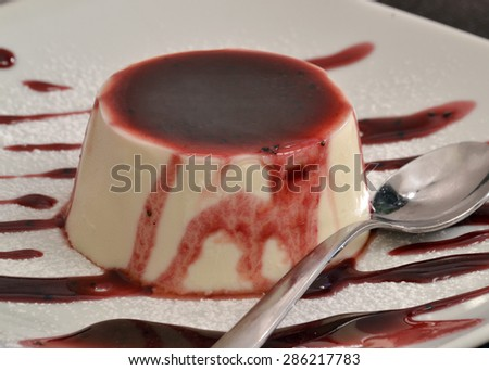 Vanilla pudding and caramel syrup.Panna cotta cake and syrup. - stock photo