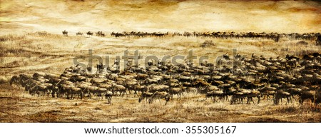 Vanishing Africa: vintage style image of a Blue Wildebeest herd in the Maasai Mara National Park in Kenya - stock photo