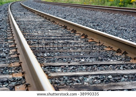 Vanishing twin railroad tracks in close up. - stock photo