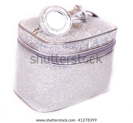 Vanity case made of  sequins, with little round mirror on the top. - stock photo