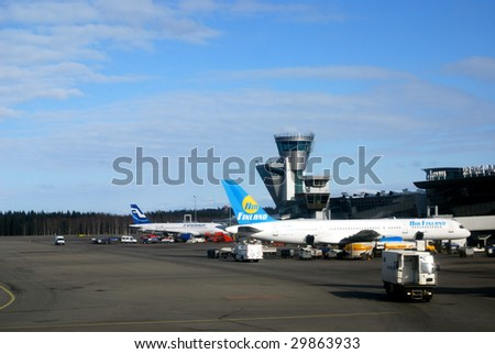 VANTAA, Finland - MARCH 19: The Helsinki-Vantaa Intl. Airport in Finland, seen here on March 19, 2009, is expanding by adding a new terminal. Departure hall numbers will be changed in fall 2009. - stock photo