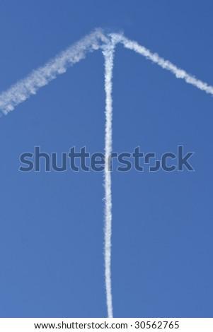 Vapour Trail Arrow on Blue Sky - stock photo