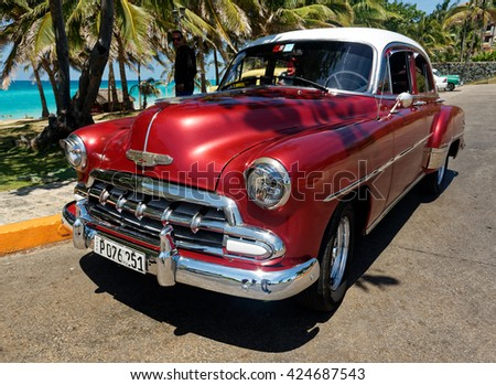 VARADERO, CUBA May 13, 2016: Classic Old American cars are used for transportation and tourism services in Cuba due to embargo - stock photo