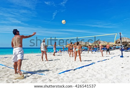 VARADERO, CUBA - May 13, 2016: Happy tourist playing beach volleyball. After more then five decades of restriction American tourist now can visit Cuba - stock photo