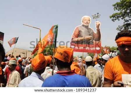 VARANASI-APRIL 24: Narendra Modi supporters walking in a political rally  in his support  on April  24, 2014 in Varanasi , India. - stock photo