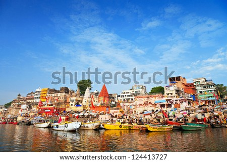 VARANASI, INDIA - APRIL 12: Boats at the river ganges on the auspicious Maha Shivaratri festival on April 12, 2012 at Dasashwamedh ghat in Varanasi, Uttar Pradesh, India - stock photo