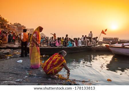 VARANASI, INDIA - APRIL 18: Crowd of local Indian live their morning life with Ganga river on April 18, 2010 in Varanasi, India. The most holy river of India and Hindu culture. - stock photo