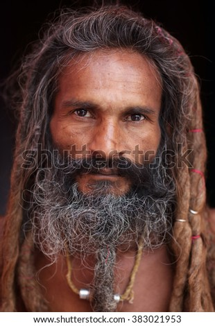 VARANASI - INDIA - DECEMBER 21, 2015: Unidentified sadhu (holy man) on the ghats of Ganges on December 21, 2015 in Varanasi, India. Varanasi is the holiest of the seven sacred cities in India. - stock photo