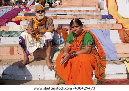 VARANASI, INDIA- MAR 09 : Unidentified  Hindu pilgrims carrying out a religious ceremony at the sacred ghats of holy river Ganges, March 09, 2013 Varanasi, Uttar Pradesh, India. - stock photo