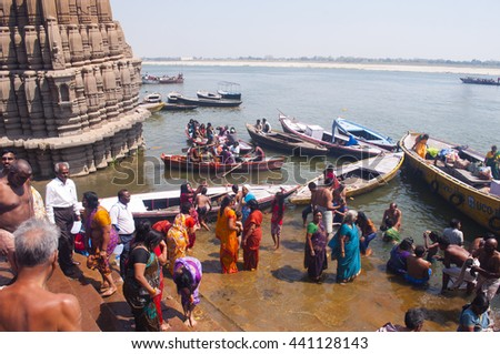VARANASI, INDIA- MAR 09:Unidentified Hindu pilgrims take bath in the Holy river Ganges on the auspicious Maha Shivaratri festival on March 09, 2013 at the ghats of Varanasi, Uttar Pradesh, India. - stock photo
