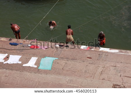 VARANASI, INDIA- MAR 03:Unidentified pilgrims take bath in the holy river Ganges on March 03, 2016 in Varanasi, Uttar Pradesh, India.Varanasi is the most popular pilgrim place in India. - stock photo